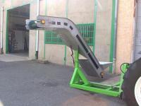 Convoyeur avec avancement hydraulique